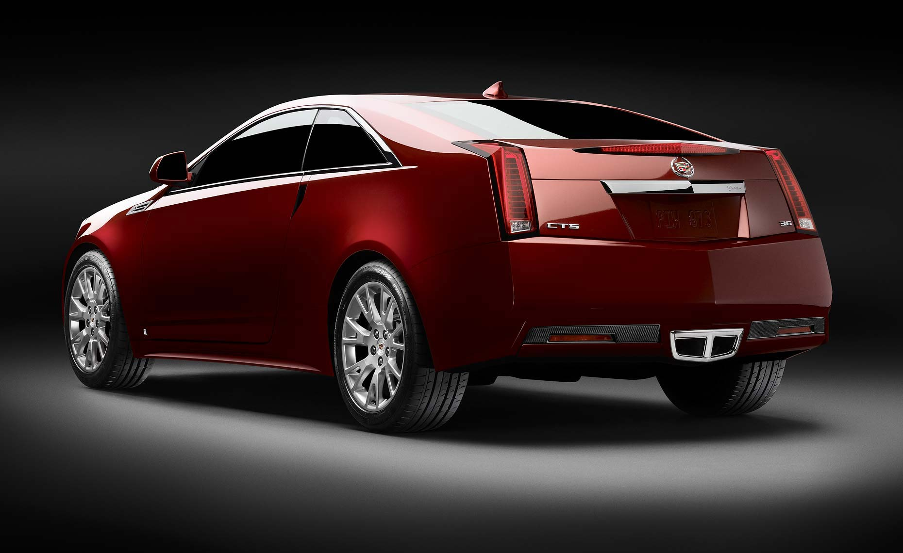 cadillac cts red coupe-3qtr-rear.jpg